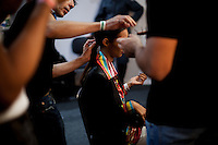 A model gets her hair done backstage for the Brazilian brand, Neon, at São Paulo Fashion Week for Summer Season 2013/2014, at Bienal, in São Paulo, Brazil, on Wednesday, March 20, 2013.