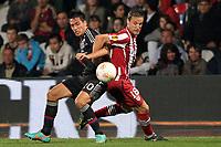 FOOTBALL - UEFA EUROPA LEAGUE 2012/2013 - GROUP STAGE - GROUP I - OLYMPIQUE LYONNAIS v ATHLETIC BILBAO - 25/10/2012 - PHOTO EDDY LEMAISTRE / DPPI - FABIAN MONZON  (OL) AND CARLOS GURPEGI  (ACB)