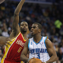 Jan 02, 2010; New Orleans, LA, USA; New Orleans Hornets guard Chris Paul (3) drives in against Houston Rockets guard Aaron Brooks (0) during the fourth quarter at the New Orleans Arena. Mandatory Credit: Derick E. Hingle-US PRESSWIRE