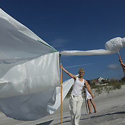 "Artists set up a ""Volo"" during the SARUS Festival Sunday August 24, 2014 at Wrightsville Beach, N.C. (Jason A. Frizzelle)"