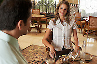 Young woman and man sitting in restaurant.