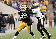 15 NOVEMBER 2008: Iowa running back Shonn Greene (23) stiff arms Purdue safety Brandon King (7) in the second half of an NCAA college football game against Purdue, at Kinnick Stadium in Iowa City, Iowa on Saturday Nov. 15, 2008. Iowa beat Purdue 22-17.