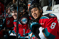 KELOWNA, BC - SEPTEMBER 28: Trevor Wong #8 and Kyle Crosbie #18 of the Kelowna Rockets pose for a photo on the bench against the Everett Silvertips  at Prospera Place on September 28, 2019 in Kelowna, Canada. (Photo by Marissa Baecker/Shoot the Breeze)