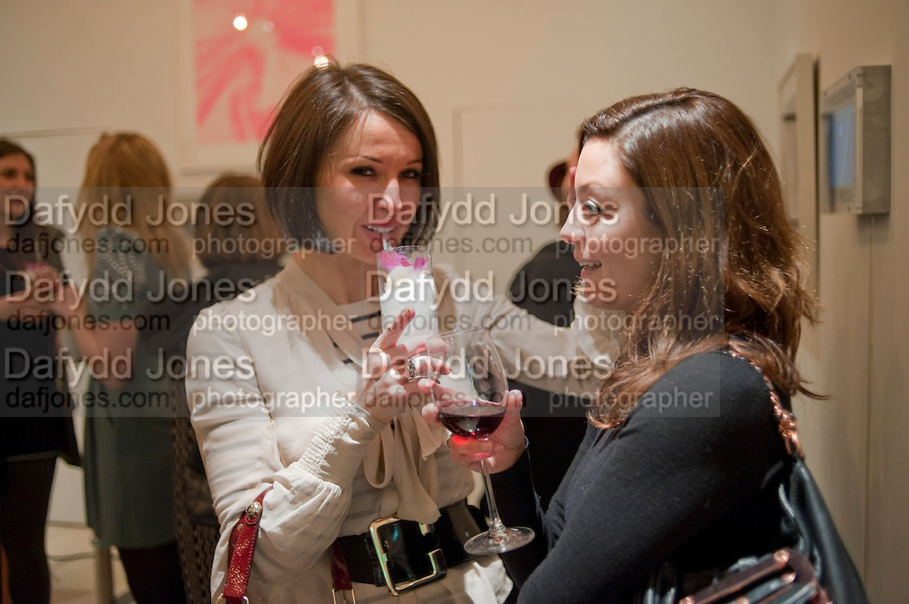 NINA RENNIE; NAOMI WILLIAMS, THE  Vinyl Factory opening OF a pop-up store in the St. Martin's Lane Hotel. 8 March 2011. -DO NOT ARCHIVE-© Copyright Photograph by Dafydd Jones. 248 Clapham Rd. London SW9 0PZ. Tel 0207 820 0771. www.dafjones.com.