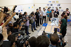 © Licensed to London News Pictures. 30/04/2014. Sulaimaniya, Iraq. Iraqi-Kurdish media watch officials count ballot papers in a school used as a polling station after voting closes for the 2014 Iraqi parliamentary elections in Sulaimaniya, Iraqi-Kurdistan today (30/04/2014). <br /> <br /> The period leading up to the elections, the fourth held since the 2003 coalition forces invasion, has already seen polling stations in central Iraq hit by suicide bombers causing at least 27 deaths. Photo credit: Matt Cetti-Roberts/LNP