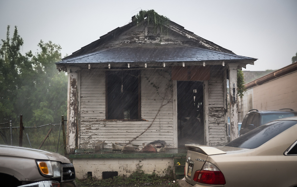 June 12, 2015, New Orleans, LA, rain pounds on a blighted home nearly 10 years after Hurricane Katriana.