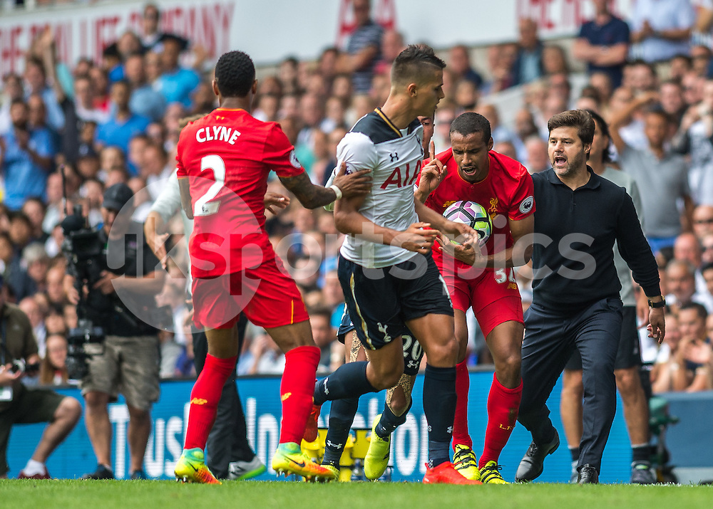Mauricio Pochettino manager of Tottenham Hotspur, and Joel Matip of Liverpool clash during the Premier League match between Tottenham Hotspur and Liverpool at White Hart Lane, London, England on 27 August 2016. Photo by Vince  Mignott.