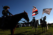 "Participants in the ""Keiki Rodeo"" (Children's Rodeo) line up before ceremoniously parading around Parker Ranch arena at the start of the Big Island Keiki Rodeo Competition in Waimea, HI.  The Hawaiian flag, at left, is displayed proudly alongside the United States flag."