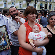Georgians in a demonstration in the country's capital city Tbilisi..Thousands of people have gather to create a human chain throughout Tbilisi in order to demonstrate against the Russian occupation of the proclaimed independent regions of South Ossetia and Abkhazia. The demonstration ended with a speech from the georgian president Mikheil Saakashvili from the veranda of the Tbilisi city council building situated in the Freedom Square.