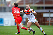Sheffield Eagles centre Paddy Flynn (24) is stopped by Bradford Bulls winger Omari Caro (18) during the Kingstone Press Championship match between Sheffield Eagles and Bradford Bulls at, The Beaumont Legal Stadium, Wakefield, United Kingdom on 3 September 2017. Photo by Simon Davies.