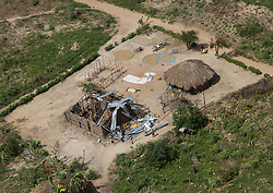 March 27, 2019 - Beira, Mozambique - Children play around a destroyed roof of a house near Gwaragwara rural area. The deadly cyclone and hammering rains have left more than 1000 people dead in Mozambique alone. It is one of the largest humanitarian disasters the region has ever faced. It is estimated by the UN that 350,000 people are still at risk. UNICEF warned that 900,000 children have been affected; either orphaned, separated from their families or lacking basic necessities. (Credit Image: © Tafadzwa Ufumleli/ZUMA Wire)