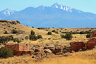 Ruins of the Box Canyon dwellings, with the San Francisco Peaks in the background - Wupatki National Monument, AZ