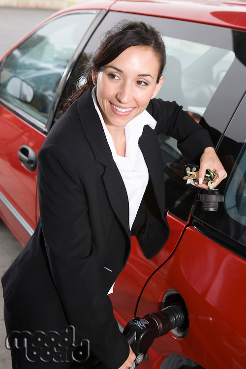 Business woman with fuel pump