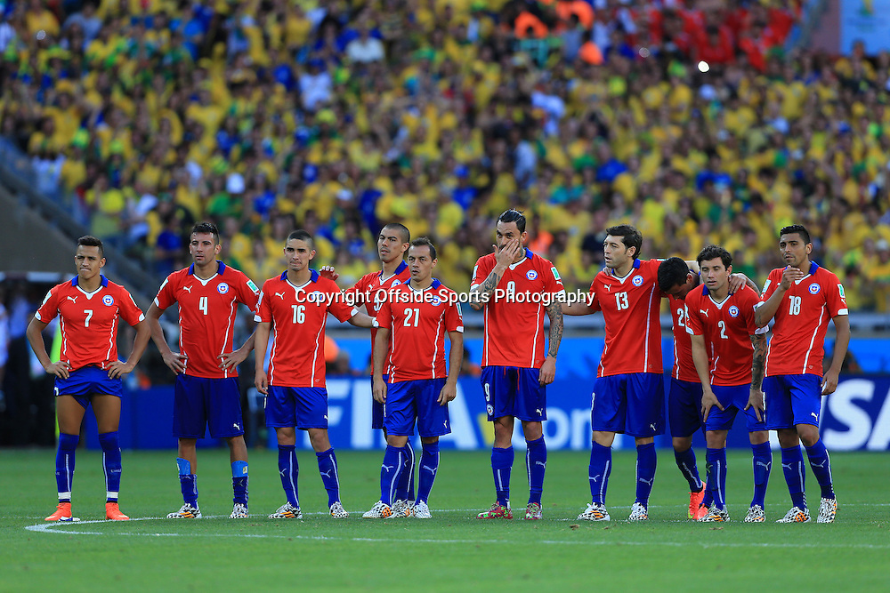 28th June 2014 - FIFA World Cup - Round of 16 - Brazil v Chile - Chile players look dejected as they edge closer to elimination during the shootout - Photo: Simon Stacpoole / Offside.