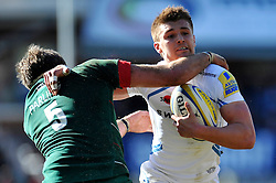 Henry Slade of Exeter Chiefs is tackled by Geoff Parling of Leicester Tigers - Photo mandatory by-line: Patrick Khachfe/JMP - Mobile: 07966 386802 28/03/2015 - SPORT - RUGBY UNION - Leicester - Welford Road - Leicester Tigers v Exeter Chiefs - Aviva Premiership