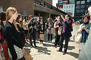 JULIA ROYCE LEADING THE ART TOUR OUTSIDE RACHEL WHITEREAD'S STUDIO, Design Your Own Timberland breakfast and Autumn/ Winter 2011 preview. Timberland. 1 Fournier St. London. Followed by an art tour by Julia Royce. 8 June 2011. <br /> <br />  , -DO NOT ARCHIVE-&copy; Copyright Photograph by Dafydd Jones. 248 Clapham Rd. London SW9 0PZ. Tel 0207 820 0771. www.dafjones.com.