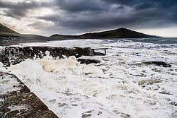 © London News Pictures. 11/01/2016. Aberystwyth, UK. As the weather starts to change , stormy seas and gales begin to hit the coastline in Aberystwyth Wales. Strong winds are affecting much of North East UK, and freezing conditions with snow are forecast for much of the country on Thursday and Friday. Photo credit:Keith Morris/LNP