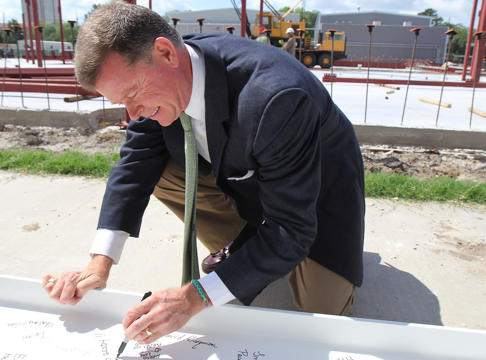 HISD Trustee Harvin Moore signs a beam on Monday, May 5, 2015, in celebration of vertical construction on the Grady Middle School's new classroom wing.