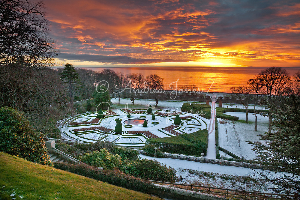 Sunrise over the snow covered East Parterre with the North Sea in the background<br /> <br /> <br /> <br /> Dunrobin Castle Sutherland, Scotland