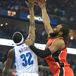 30 January 2009:  Golden State Warriors forward Ronny Turiaf (21) shoots as New Orleans Hornets forward Julian Wright (32) defends during a 91-87 loss by the New Orleans Hornets to Golden State Warriors at the New Orleans Arena in New Orleans, LA.