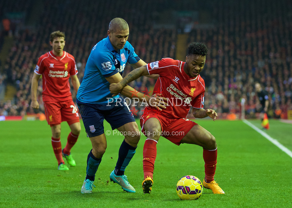 LIVERPOOL, ENGLAND - Saturday, November 29, 2014: Liverpool's Raheem Sterling in action against Stoke City's Jonathan Walters during the Premier League match at Anfield. (Pic by David Rawcliffe/Propaganda)