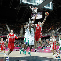 02 August 2012: Russia Anton Ponkrashov goes for the layup past Brazil Larry Taylor and Nene Hilario during 75-74 Team Russia victory over Team Brazil, during the men's basketball preliminary, at the Basketball Arena, in London, Great Britain.