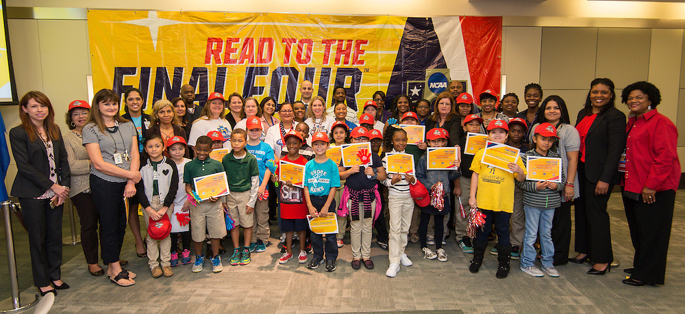 Pablo Alsina poses with the representatives of the 32 finalists in the Houston ISD NCAA Read to the Final Four, November 11, 2015.