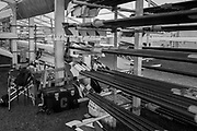 """Henley-on-Thames. United Kingdom. """"Cornell Corner"""" Cornell University `USA. Oars racked and surronded by Boatman and coaches equipment.  2017 Henley Royal Regatta, Henley Reach, River Thames. <br /> <br /> 07:00:05  Tuesday  27/06/2017   <br /> <br /> [Mandatory Credit. Peter SPURRIER/Intersport Images."""