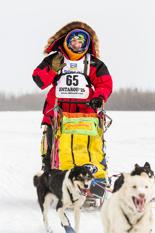 Musher Wade Marrs competing in the 43rd Iditarod Trail Sled Dog Race on the Chena River after leaving the restart in Fairbanks in Interior Alaska.  Afternoon. Winter.