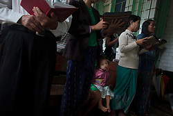 Kachin refugees attend a mass in Laiza Church in Laiza village close to the China border, Myanmar on July 15, 2012. According to KIO (Kachin Independence Organization) sources 99% of Laiza villagers are Christians also according to the same sources around 50000 Kachin people live as refugees in those camps.