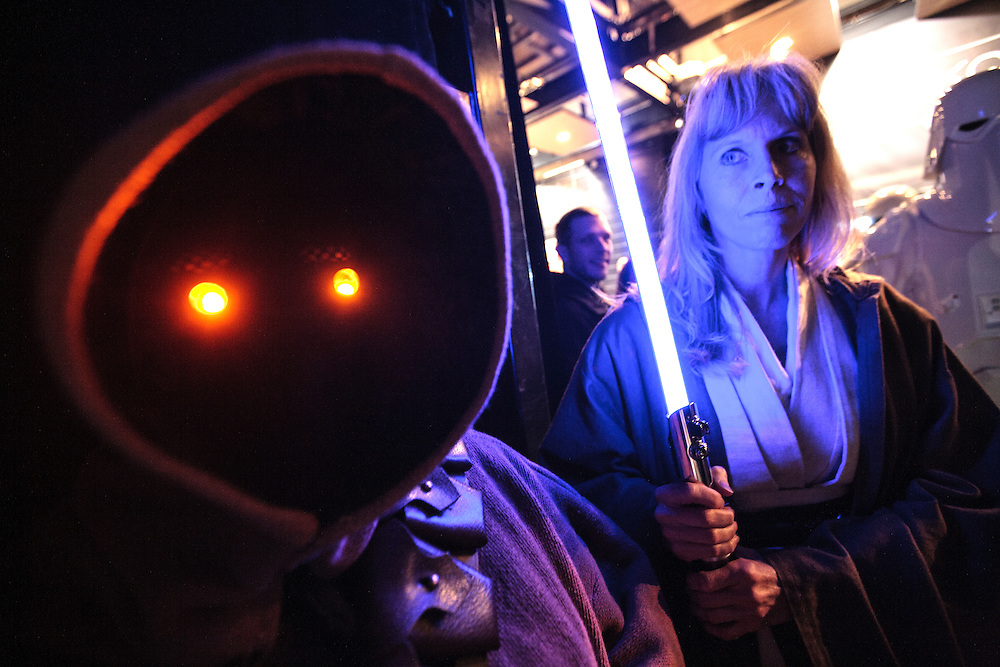 Amanda Fineran, left, of Bloomington portrays a Jawa and Jenny Braun of Hampton holds a light saber as a Jedi while the two await an appearance on the court by the 501st Legion Central Garrison at the Timberwolves game at Target Center in Minneapolis December 15, 2015.