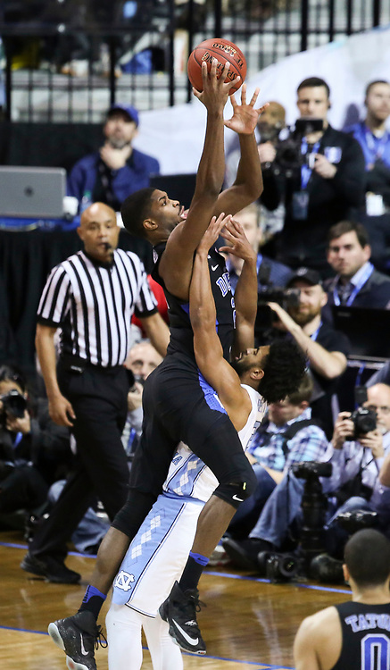 Duke forward Amile Jefferson (21) drives into North Carolina guard Joel Berry II (2) during the semifinals of the 2017 New York Life ACC Tournament at the Barclays Center in Brooklyn, N.Y., Friday, March 10, 2017. (Photo by David Welker, theACC.com)