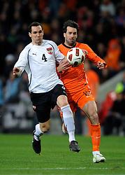 09-02-2011 VOETBAL: NEDERLAND - OOSTENRIJK: EINDHOVEN<br /> Netherlands in a friendly match with Austria won 3-1 / Ruud van Nistelrooij NED and Emanuel Pogatetz AUT<br /> ©2011-WWW.FOTOHOOGENDOORN.NL
