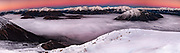 Waimakariri River valley filled with cloud, alpenglow at dawn, winter panorama from Mt Binser, Canterbury, New Zealand