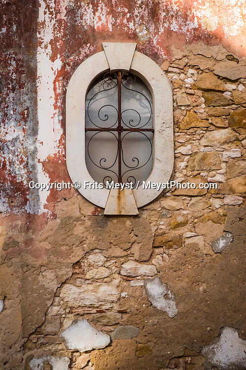 Faro, Algarve, Portugal, October 2014. The old part of Faro. A spectacular coastline of steep sandstone cliffs borders hidden sandy beaches on the south western tip of Europe, where the Mediterranean becomes the Atlantic Ocean.  Photo by Frits Meyst / MeystPhoto.com