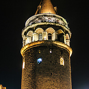Istanbul's Tower of Galata, occupying a high point in the Beyoğlu district, at night.