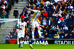 George Williams of Milton Keynes Dons heads the ball away from Alex MacDonald of Mansfield Town - Mandatory by-line: Ryan Crockett/JMP - 04/05/2019 - FOOTBALL - Stadium MK - Milton Keynes, England - Milton Keynes Dons v Mansfield Town - Sky Bet League One