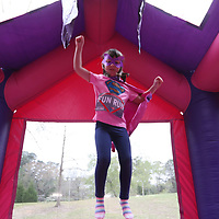 Natalie Getz, 5, practices her superhero moves Saturday morning at the CASA Superhero Run in Oxford, MS