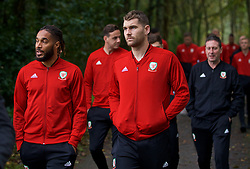 CARDIFF, WALES - Sunday, October 13, 2019: Wales' captain Ashley Williams (L) and Sam Vokes during a pre-match team walk at the Vale Resort ahead of the UEFA Euro 2020 Qualifying Group E match between Wales and Croatia. (Pic by David Rawcliffe/Propaganda)