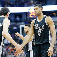 08 April 2016: San Antonio Spurs center Tim Duncan (21) is seen next to San Antonio Spurs center Boban Marjanovic (40) during the Denver Nuggets 102-98 victory over the San Antonio Spurs, at the Pepsi Center, Denver, Colorado, USA.
