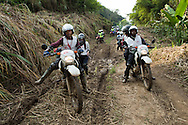 Staff of Medecins Sans Frontieres return from a medical outreach in the village of Lukweti, Masisi in conflict-ridden North Kivu, Democratic Republic of Congo, July 29, 2014.  The village, only reachable by motorcycle a narrow dirt road, can take up to five hours to navigate from the closest MSF base in the rainy season.