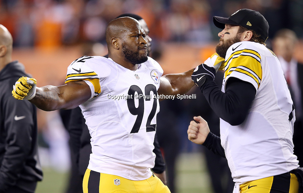 Pittsburgh Steelers outside linebacker James Harrison (92) takes a fake punch from Pittsburgh Steelers quarterback Ben Roethlisberger (7) as part of their standard pregame ritual before the NFL AFC Wild Card playoff football game against the Cincinnati Bengals on Saturday, Jan. 9, 2016 in Cincinnati. The Steelers won the game 18-16. (©Paul Anthony Spinelli)
