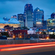 Kansas City Missouri skyline at dusk with car traffic motion blur in foreground