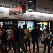 Passengers waiting for a train at a Hong Kong subway station