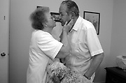 Fabiola Trejo gives her husband a kiss after dressing him in their Newark, Calif. home May 31, 2005. Robert was diagnosed with Alzheimer's disease in 2002, and Fabiola cares for her husband of over 60 years alone.