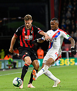 Simon Francis (2) of AFC Bournemouth battles for possession with Jordan Ayew (14) of Crystal Palace during the Premier League match between Bournemouth and Crystal Palace at the Vitality Stadium, Bournemouth, England on 1 October 2018.