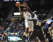 """Ole Miss' Martavious Newby (1) and Ole Miss' Demarco Cox (4) vs. East Tennessee State's Kinard Gadsden-Gilliard (35) at the C.M. """"Tad"""" Smith Coliseum in Oxford, Miss. on Saturday, December 14, 2012. Mississippi won 77-55 to improve to 7-1. (AP Photo/Oxford Eagle, Bruce Newman).."""