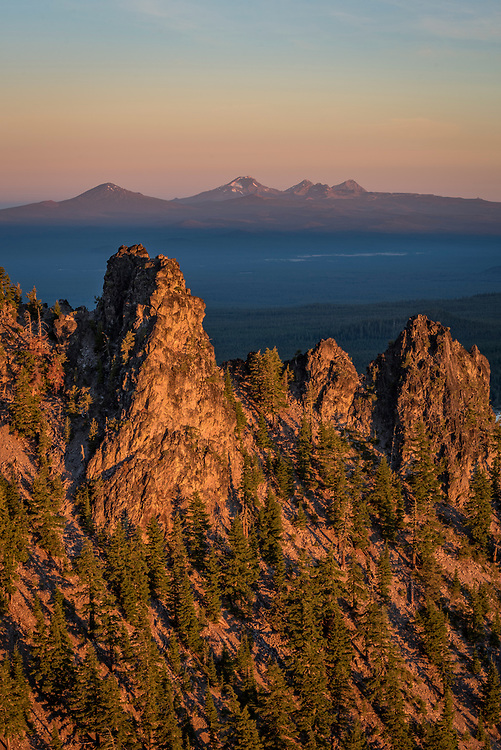 View from Paulina Peak at Newberry National Volcanic Monument in Central Oregon. In the distance: (l to r) Mount Bachelor, South Sister, Broken Top.