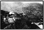 CUKURCA, HAKKARI, TURKEY, 10.04.91. Kurdish refugees arrive in the refugeecamp near Cukurca, after they were attacked by the Iraqi Army during the Kurdish uprising against Saddam Houssein. The revolt occured at the end of the Gulf war when the Iraqi army was thought to be defeated. The refugees walked sometimes barefeet through the snow covered  mountains, to arrive in a camp with no facilities, no food, and no medical attention, and hostile Turkish soldiers. With Saddams soldiers chasing them they were collected in camps on the Turkish border. &copy;Photo by Frits Meyst/NewsImages<br /><br />fleeing, war, victims, agony, defeated, exhausted, pain, civilians, aid, food, distribution, relief