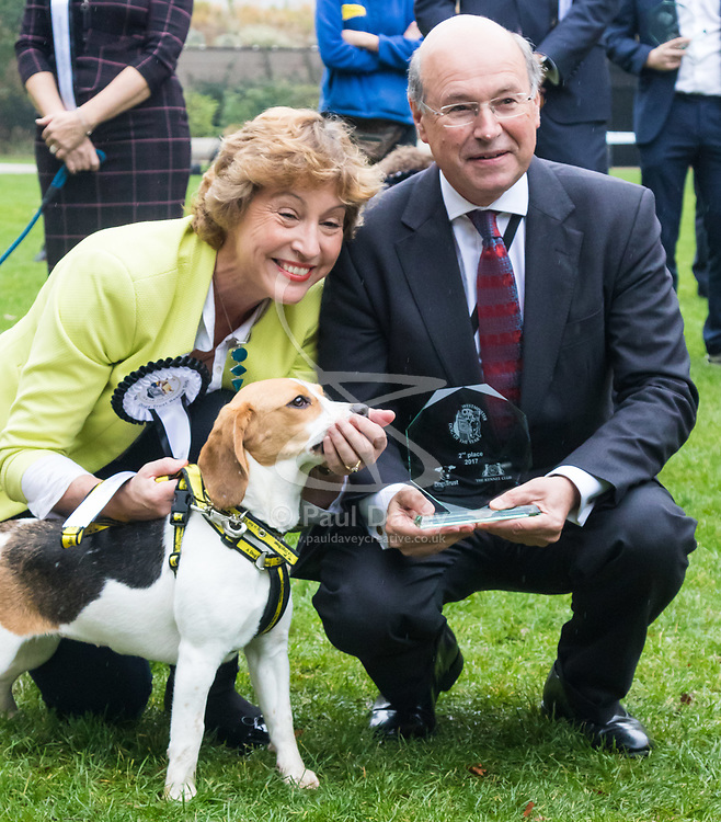 London, October 26 2017. Lord Gardiner poses withRebecca Pow MP (Conservative - Taunton Deane) and Dogs Trust rescue beagle Bonnie, who came second at the annual Kennel Club and Dogs Trust Westminster Dog Of The Year competition that sees MPs and members of the House of Lords with their dogs as well as rescue dogs from the Dogs Trust. © Paul Davey